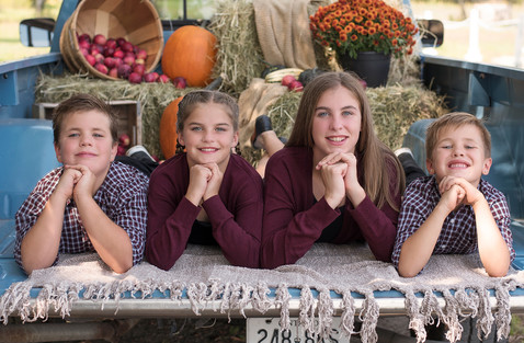 Four siblings Fall portrait