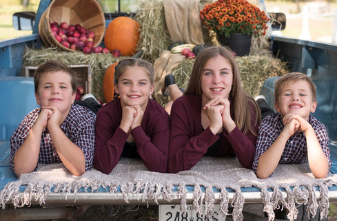 Four siblings Fall portrait