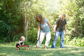 Toddler in wagon with parents