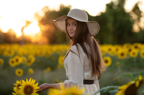 Young teen woman in sunflower field