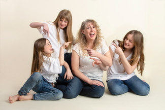 Studio family of four laughing