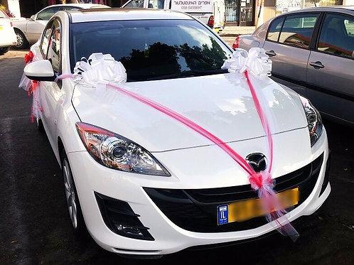 מזדה חדשה מקושט לחתונה בחנות פרחים בכרמיאל