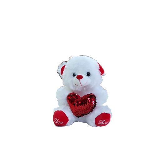 דובון לבן קטן עם לב אדום בוהק בכפותיו