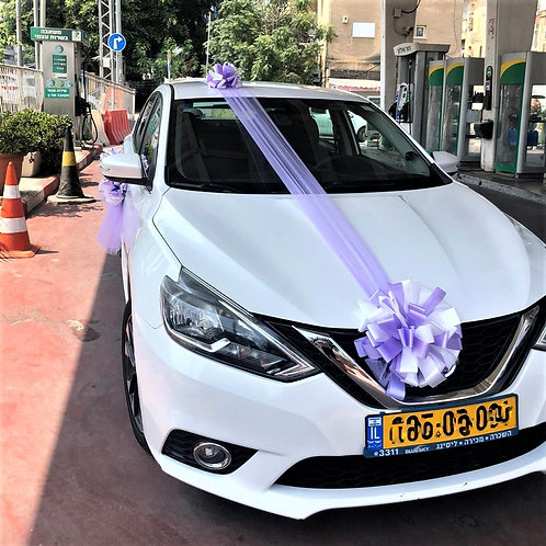 Nissan car decorated for the wedding with decoration number 92