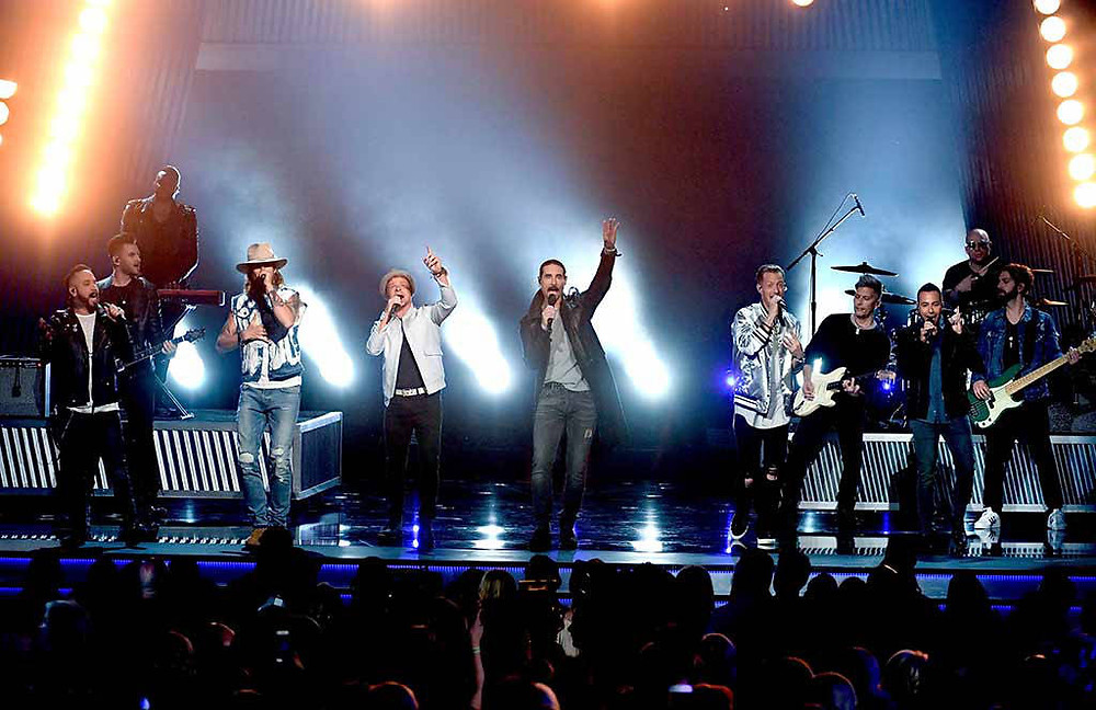 Florida Georgia Line on stage with the Backstreet Boys.