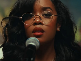 "H.E.R. Shares Her Message of Vulnerability in ""Damage"""