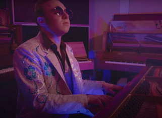 "Josh Christina is a Modern-Day Elton John in ""Old Piano"" Music Video"