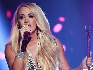Looking Back On Carrie Underwood's AMA Performance Looks