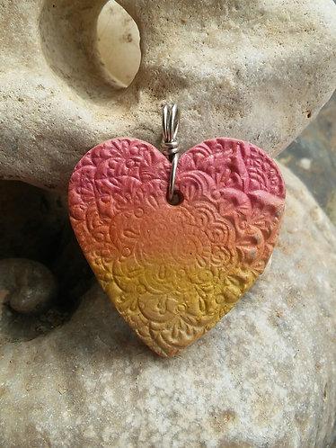 Warm hues mandala pendant