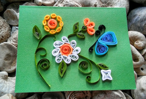Spring flowers paper quilled card my mom made this by glueing paper strips into beautiful designs and putting them on a thick card these are perfect for hanging on your wall or giving to a mightylinksfo