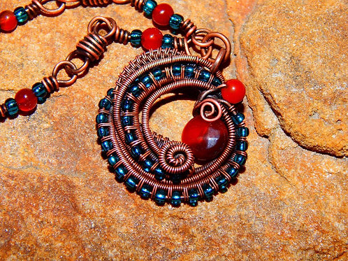 Red swirly wire wrapped necklace