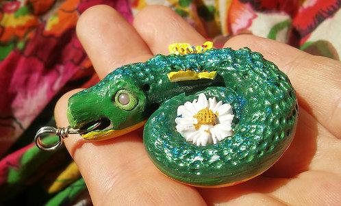 Dragon fly holding daisy pendant