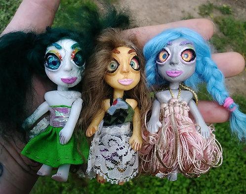 Doll trio