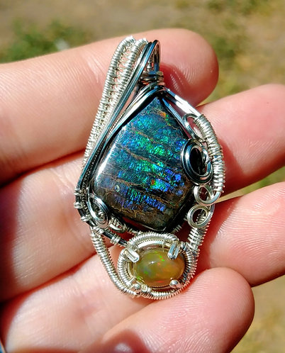 Ammolite and opal wire wrapped pendant