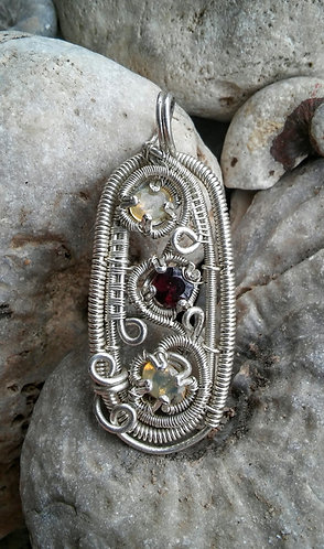 Sterling silver pendant with opals and garnet