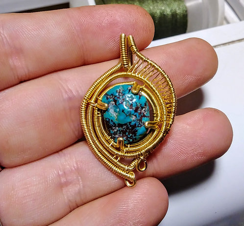 Turquoise and brass pendant