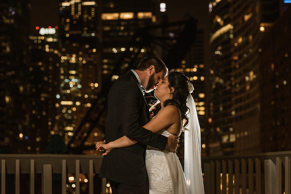 Reception night shot of bride and groom on the Rooftop of the East Bank Club in Chicago