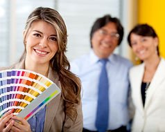 An Interior Decorator choosing paint colors with smiling clients