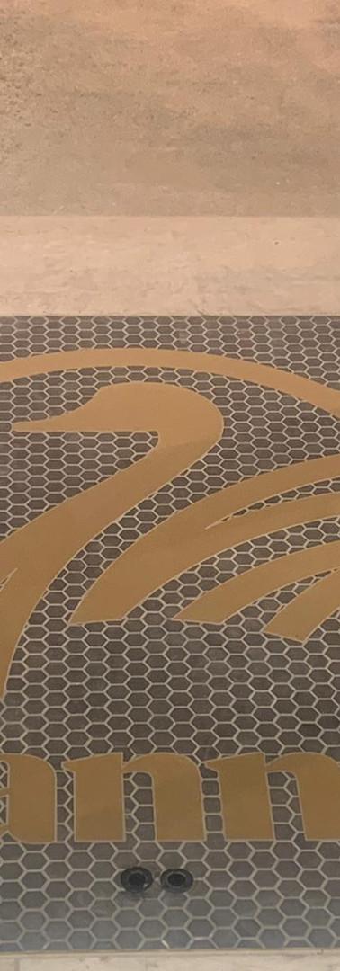 Swanndri Brass Floor logo