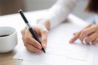 Closeup of Applicant Completing Applicat