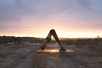 "<img src=""Downward Dog Pose.jpg"" alt=""a woman in downward dog position on a yoga mat at sunset on a roof top building"">"