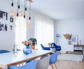 Dining and living room design, with blue and grey chairs, dark blue armchairs, designed by CPH interior design