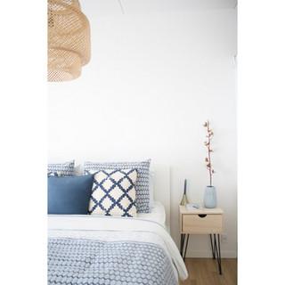 bed in blue patterned linen