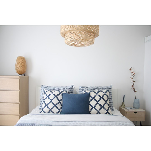 bedroom in blue and rattan