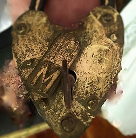 antique heart shaped padlock with letter m embost on keyway cover