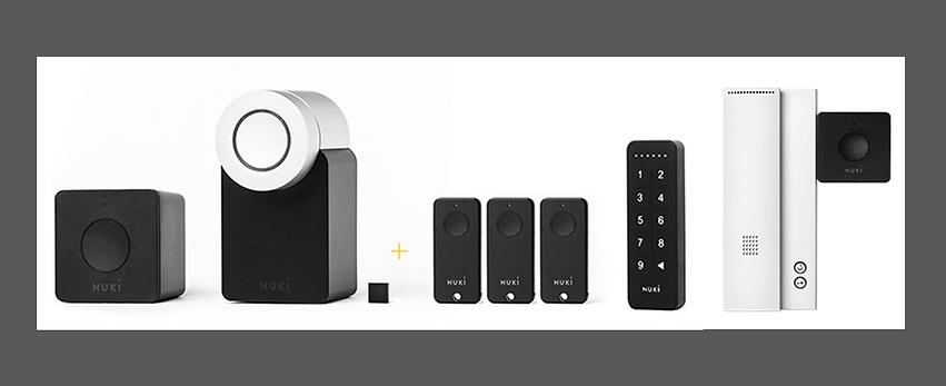 Image of the Nuki product line, lock, wifi bridge, fobs, keypad and intercom opener