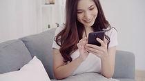 beautiful-asian-woman-using-smartphone-w