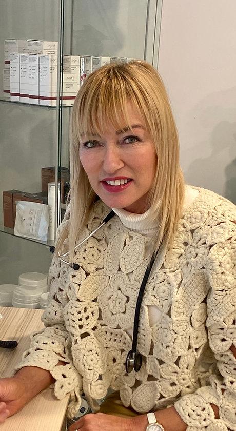Donna at desk staff photo 2021.jpg