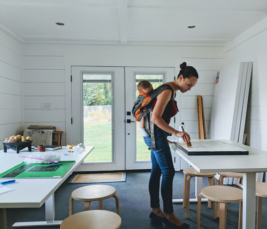 Artist Stephanie Scarlata at work in her home studio.