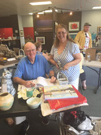 Members Tim Lauer and SaraLee Chaney checking in work for the 2019 Holiday show.