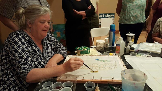 Betty Lepin provides a silk painting demo during a members meeting.