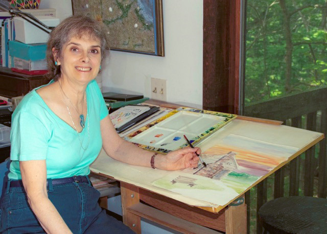 Artist Alice Yeager at work in her home studio