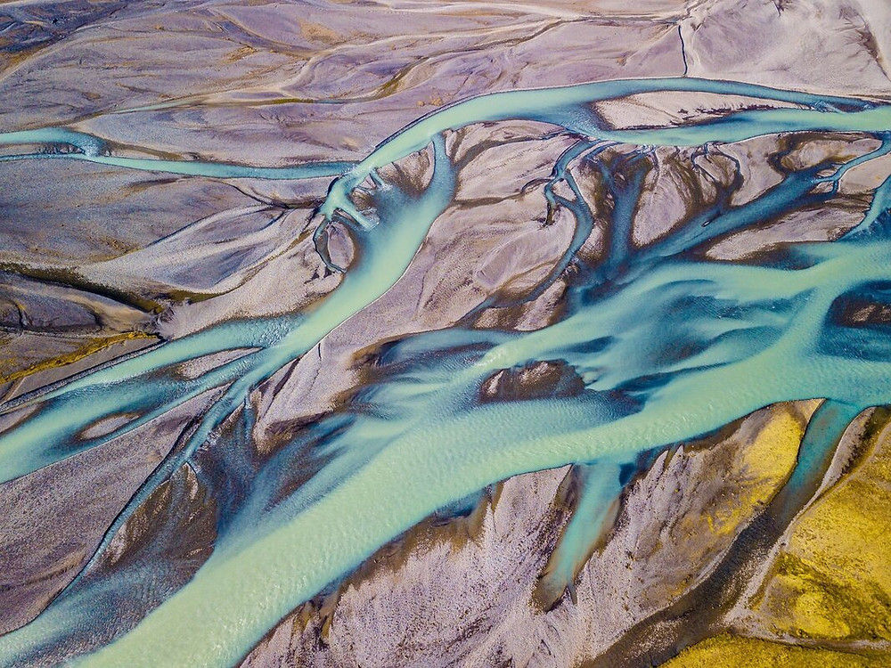Drone aerial photograph of river flow into the Artic Ocean
