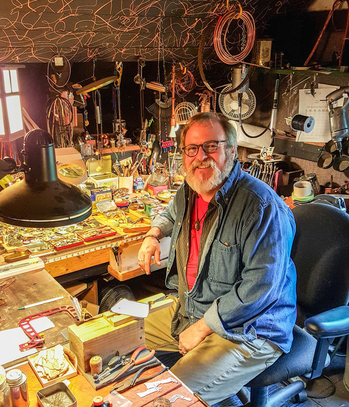 Artist Mike Dennis at work in his home studio.