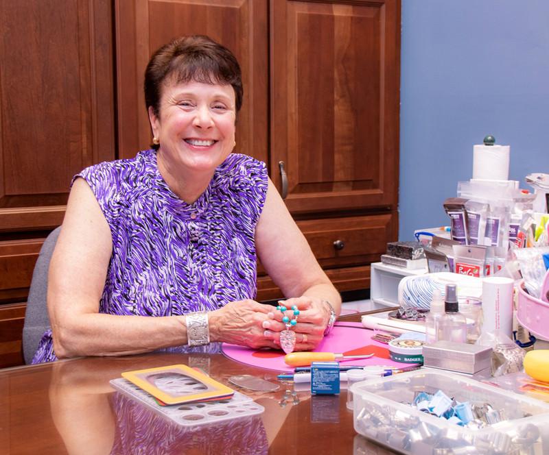 Artist Linda Donahue at work in her home studio.