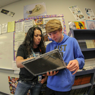 I shot this photo of a teacher advising a student using a fisheye lense to get a unique effect.