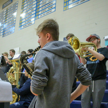 I took this photo of a band member at a basketball game. I chose to include it as it shows variety in my portfolio and is overall a solid photo.