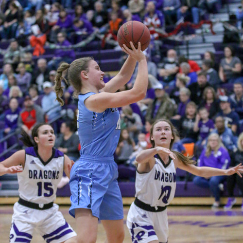I chose to include this girls basketball photo as I like the combination of the player in midair shooting and the opposing team behind.