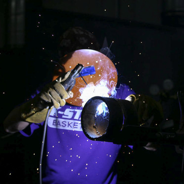 I shot this photo for a welding story and was very happy with what I came up with. I love how the sparks add detail to the image and the light illuminates just the welder.