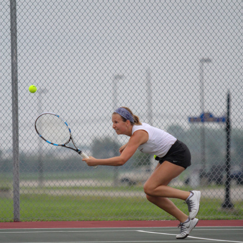 I like this tennis photo as it shows the hustle of the player to get to the ball and an interesting position.