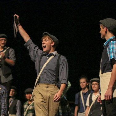 I shot this photo at a musical performance and like how the expression of the students add to make a great photo.