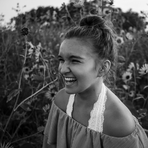 I captured this candid photo during an impromptu photoshoot with a friend. I chose to put it in black and white as it helps to add focus to the emotion from the subject.