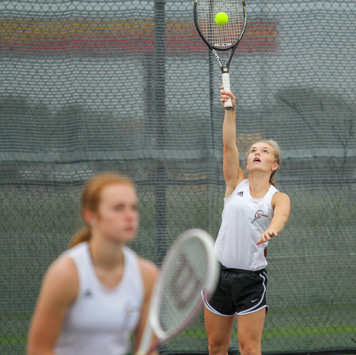 I chose to include this photo of a tennis doubles team as Iike how the focus is on the one in the back hitting the ball but yet you can still see the other player ready to go.