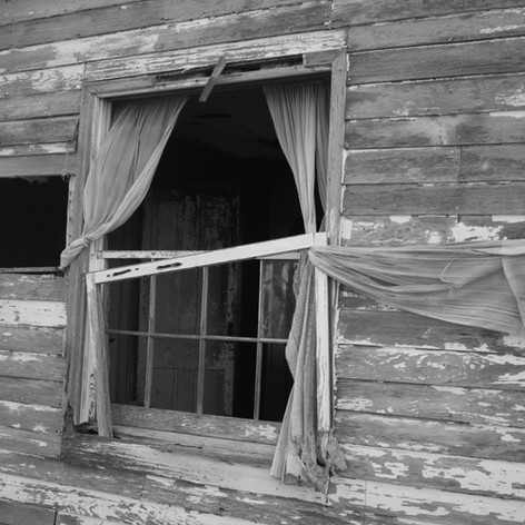 This photo was taken of an abandoned house. The chipping paint and broken glass make this an interesting shot.