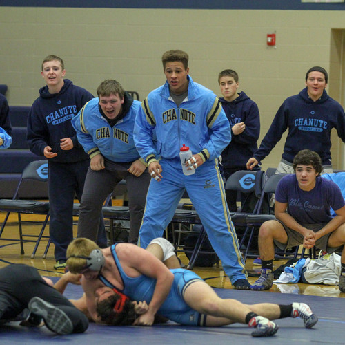 Reaction shots are some of my favorite to capture as they are able to capture the emotions of so many people. This wrestling photo shows a wrestler pinning his opponent with his team cheering him on behind.