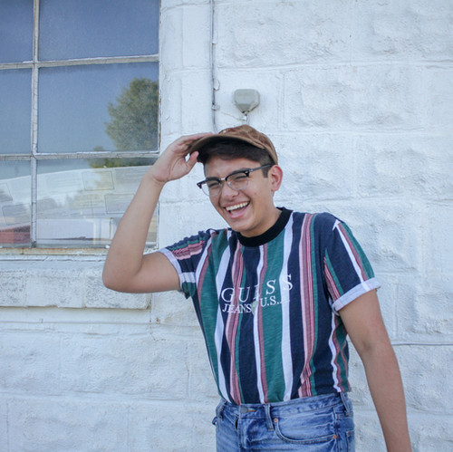 I shot this portrait of a friend in front of a simple white building to help bring out his colorful shirt.